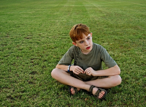 Autistic boy on grass